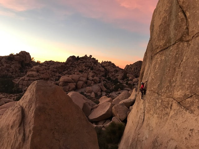 Jonathon Spitzer climbing in Joshua Tree, much like changing a diaper at 3am...