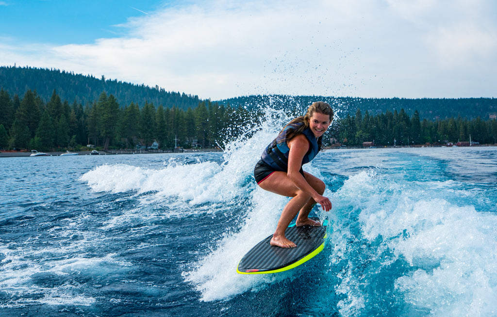 Michelle Parker tackles Lake Tahoe on a wake surf outing. Shot by Ming Poon