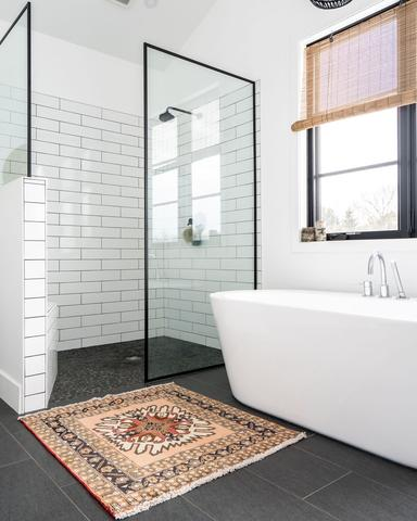 bathroom with stand up shower and soaker tub