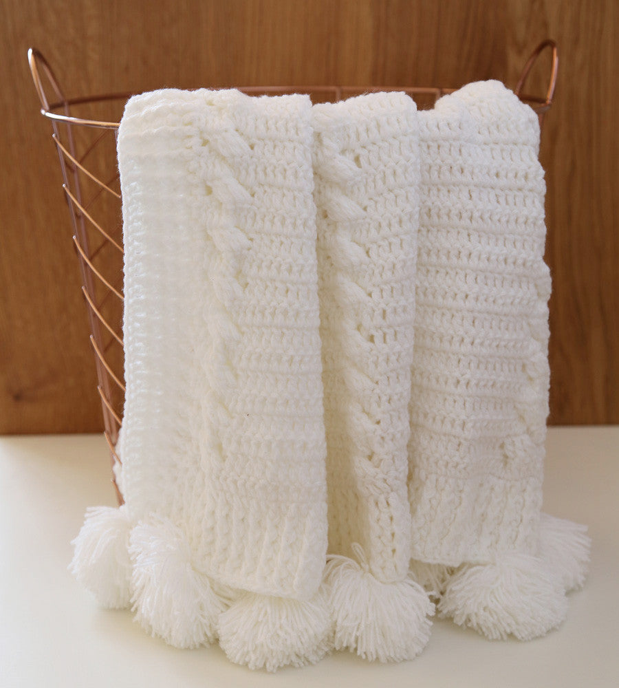 Crochet blanket with pom pom in white