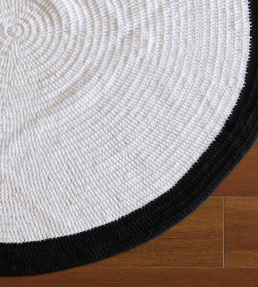 Beautiful monochrome handmade round crochet floor rug