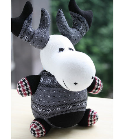 Mika the moose sock animal in black wintery colours