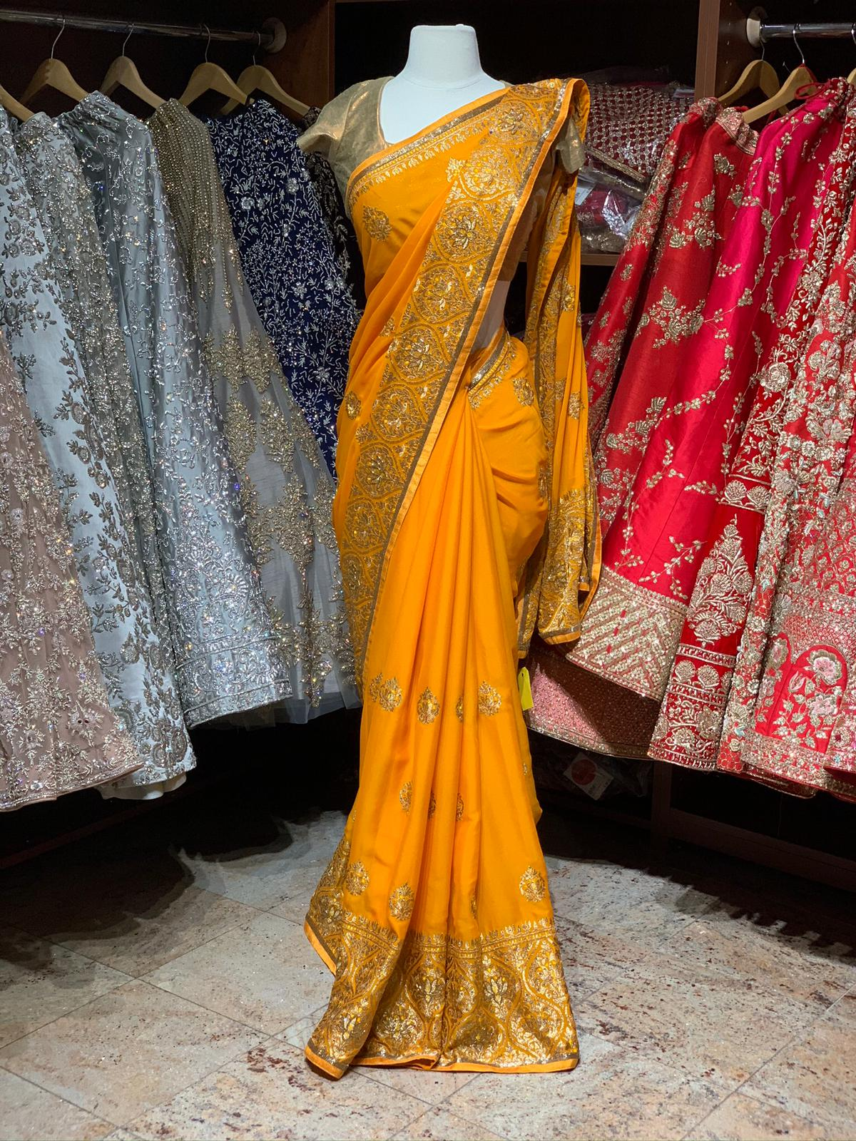 Magnificent  Yellow Georgette Saree