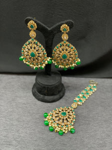 Antique gold earrings with emerald accents with Maang tikka