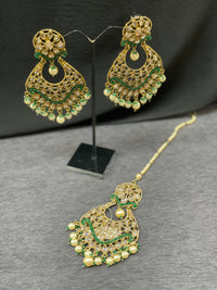 Antique gold earrings with maangtikknin emerald accents