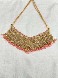 Antique gold necklace set with pink accents