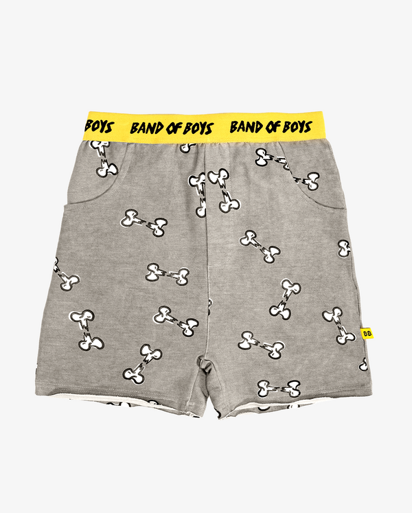 Broken bone track shorts - CPD grey boys shorts with rough hem, front pockets, small white broken bone print all over and bright yellow waist band featuring black 'bandits' text.