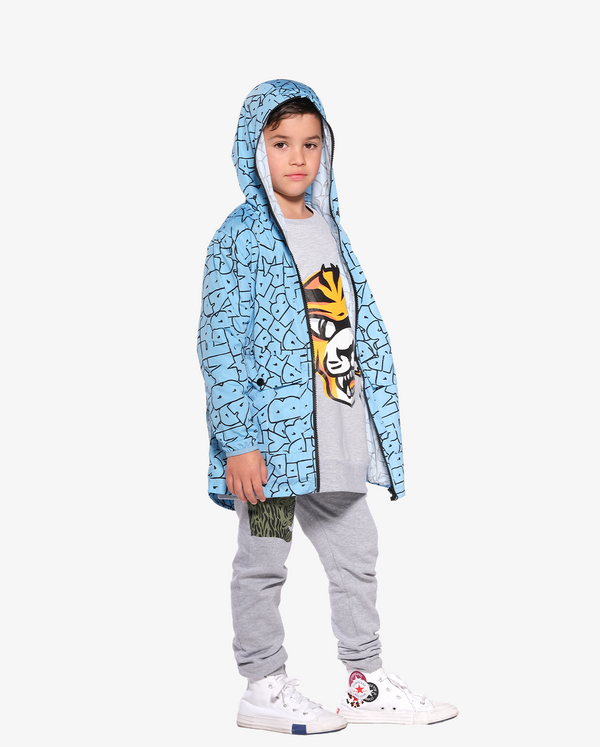 Blue Band of Boys Bubble Logo Rain Shell Jacket on model with hood up