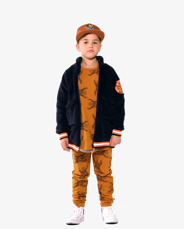 Dark Navy Band of Boys Bomber Jacket with super soft faux fur fabric and YKK zip on model.