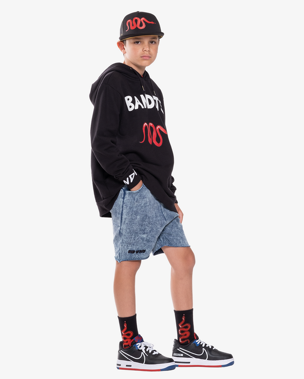 Black Band of Boys Red Viper Skate Socks from The Collectibles range on model.