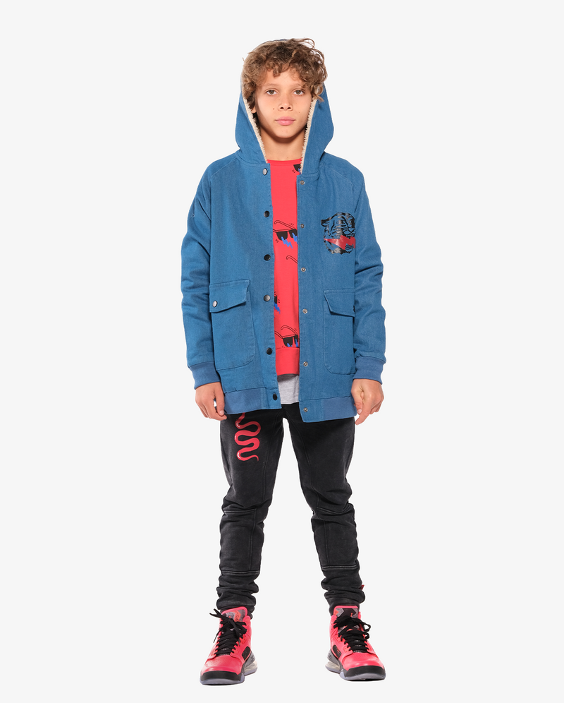 Bandits by Band of boys Lightning Tiger Bomber Jacket with faux fur lined hood on model with hood on. Model also wears lightning sunnies crew tee and Red viper trackies.