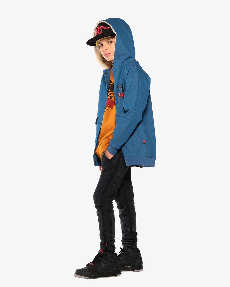Bandits by Band of boys Lightning Tiger Bomber Jacket with faux fur lined hood on model, with hood on