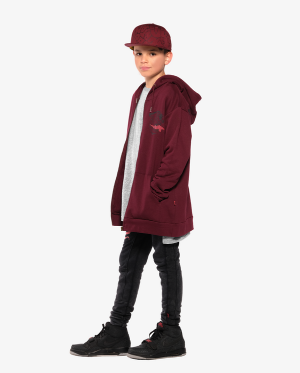 Bandits by Band of Boys Maroon Lightning Tiger Classic Zip Hood Crew on Model - side view. Model also wears Maroon Bubble Logo Cap, Black Panel Trackies with red viper and Grey snake key step hem long sleeve Tee.