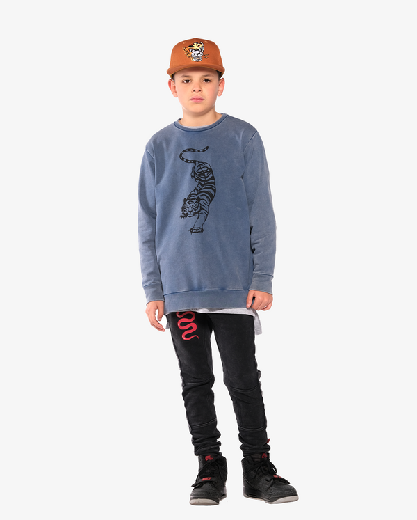 Bandits by Band of Boys Crouching Tiger Vintage Blue Crew - On model, model also wears Ochre Eye of the tiger Cap and Black Vintage Panel Trackies with Red Viper
