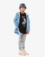 Bandits by Band of Boys Crouching Tiger Black Long Sleeve Straight Hem Tee on model. Model also wears Lightning Tiger Blue Cap and Blue Bubble logo jacket along with Crouching Tiger Grey Panel Trackies