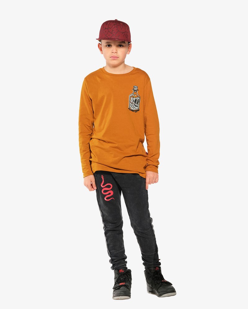 Bandits by Band of Boys Black Panel Trackies with Red Viper - Model also wears Bandits by band of boys bottle step hem tee and Bubble logo hip hop cap
