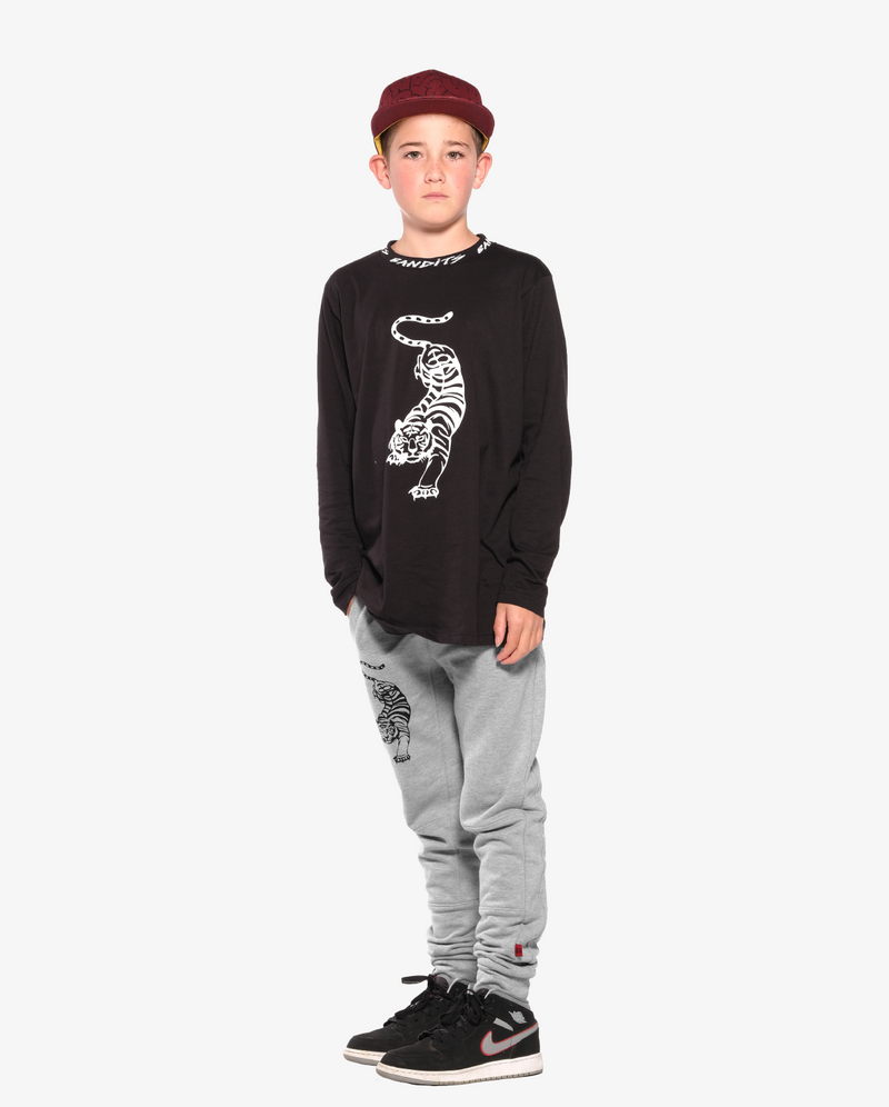 Bandits by Band of Boys Crouching Tiger Black Long Sleeve Straight Hem Tee on Model. Model wears Maroon Bubble Logo Cap and Crouching Tiger Grey Panel Trackies