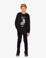 Bandits by Band of Boys Crouching Tiger Black Long Sleeve Straight Hem Tee on model - front on. Model also wears Ochre Eye of the Tiger Cap and Black Tape Trackies.