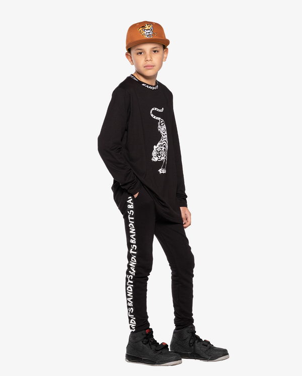 Bandits by Band of Boys Crouching Tiger Black Long Sleeve Straight Hem Tee on Model. Model also wears Eye of The Tiger Ochre Cap and Black Tape Trackies.
