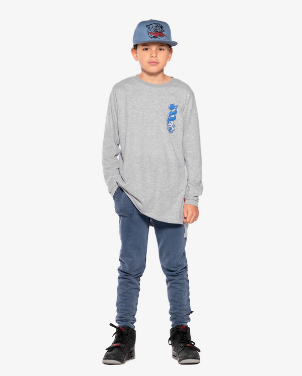 Bandits by Band of Boys Vintage Blue Pocket Skinny Trackies - Model also wears snake key step hem long sleeve grey tee and Lightning tiger Blue hip hop cap
