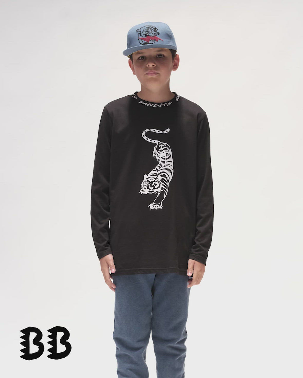 Bandits by Band of Boys Crouching Tiger Black Long Sleeve Straight Hem Tee video. Model also wears Lightning Tiger Blue Cap and blue Vintage Trackies