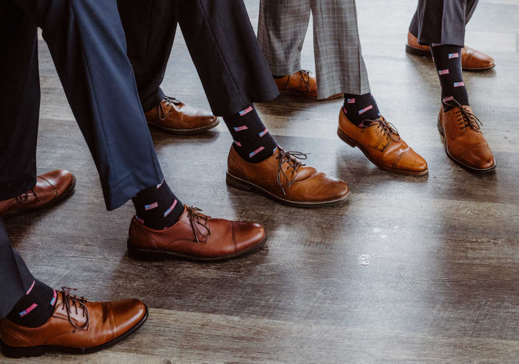 groomsmen wearing American flag dress socks for men