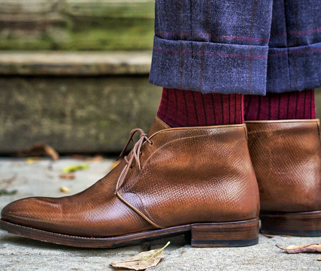 burgundy merino wool dress socks with navy windowpane trousers and light brown pebble leather chukka boots