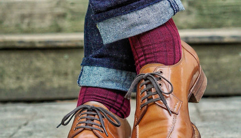 burgundy merino wool dress socks paired with selvedge denim and light brown oxfords
