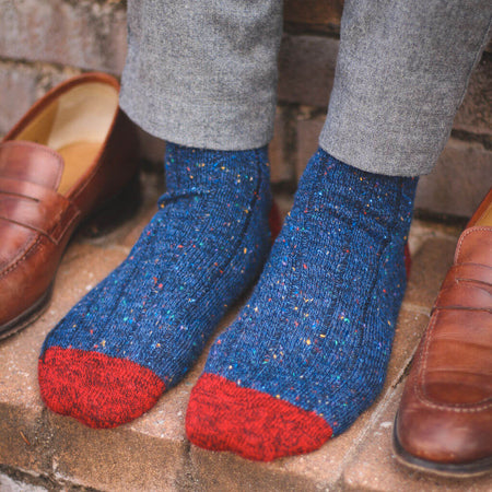 Man Wearing Navy Blue Donegal Wool Socks with a Pair of Brown Loafers
