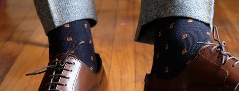 Navy Patterned Socks with Grey Trousers