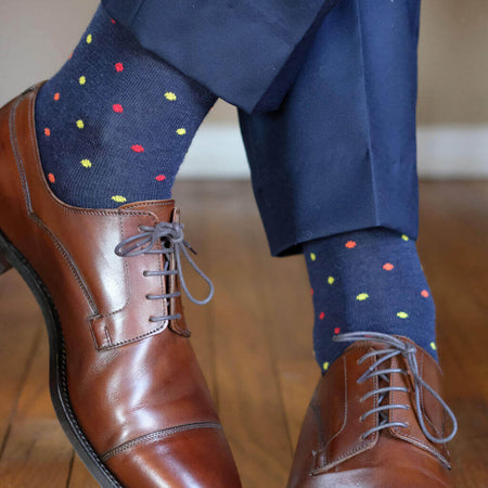 Man Wearing Navy Blue Dress Socks with Colorful Polka Dots and Brown Dress Shoes