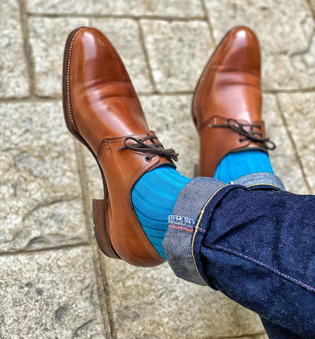 Man Wearing Teal Dress Socks with Jeans and Brown Dress Shoes