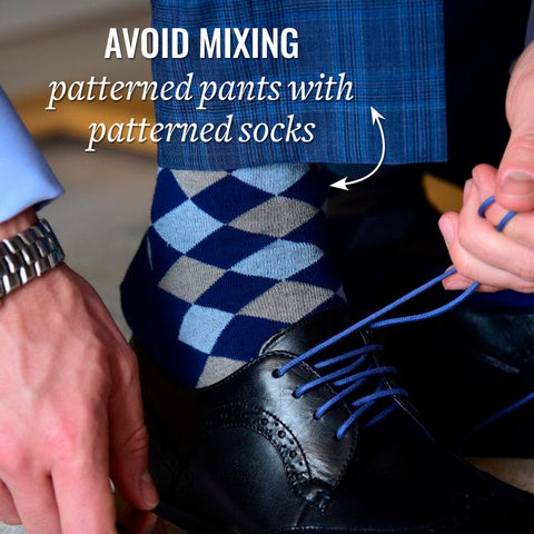 avoid mixing patterned socks with patterned blue dress pants