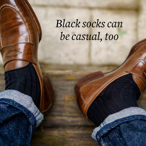 black dress socks worn casually with jeans and light brown loafers