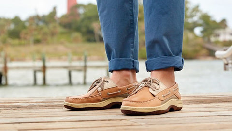 boat shoes with blue chinos and bare ankles