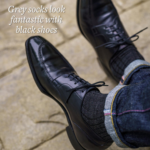grey dress socks with black shoes and blue jeans