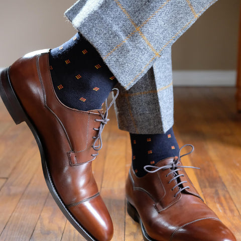 patterned grey suit with patterned navy dress socks
