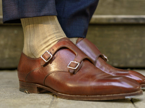 khaki dress socks with navy blue dress pants and brown shoes