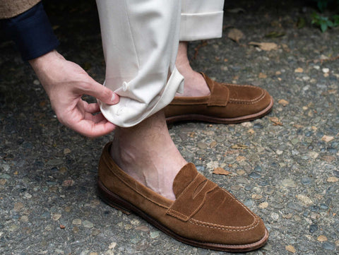 khaki pants with brown suede loafers for a stylish sockless look