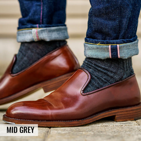 mid-grey dress socks with dark jeans and brown wholecut loafers
