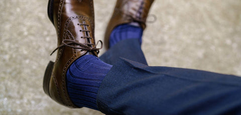blue dress socks worn with a navy suit and dark brown dress shoes