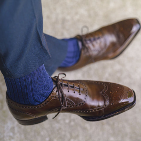 matching navy dress socks with navy pants and brown shoes