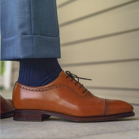 navy dress socks matched with navy pants and light brown dress shoes