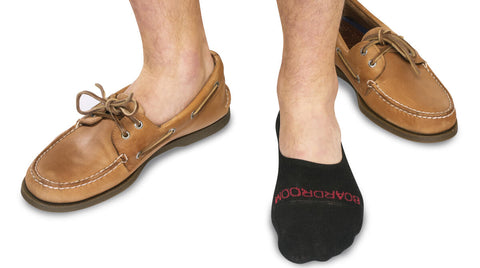 man wearing black no-show socks with brown Sperry boat shoes