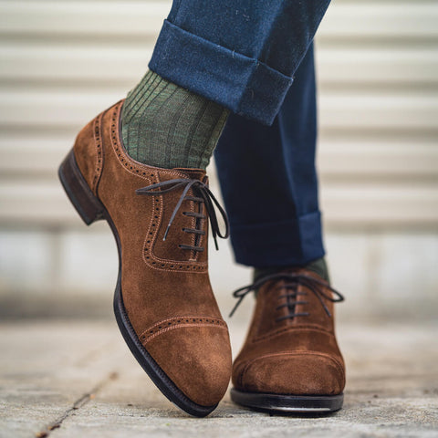 olive green dress socks matched with brown shoes and navy pants