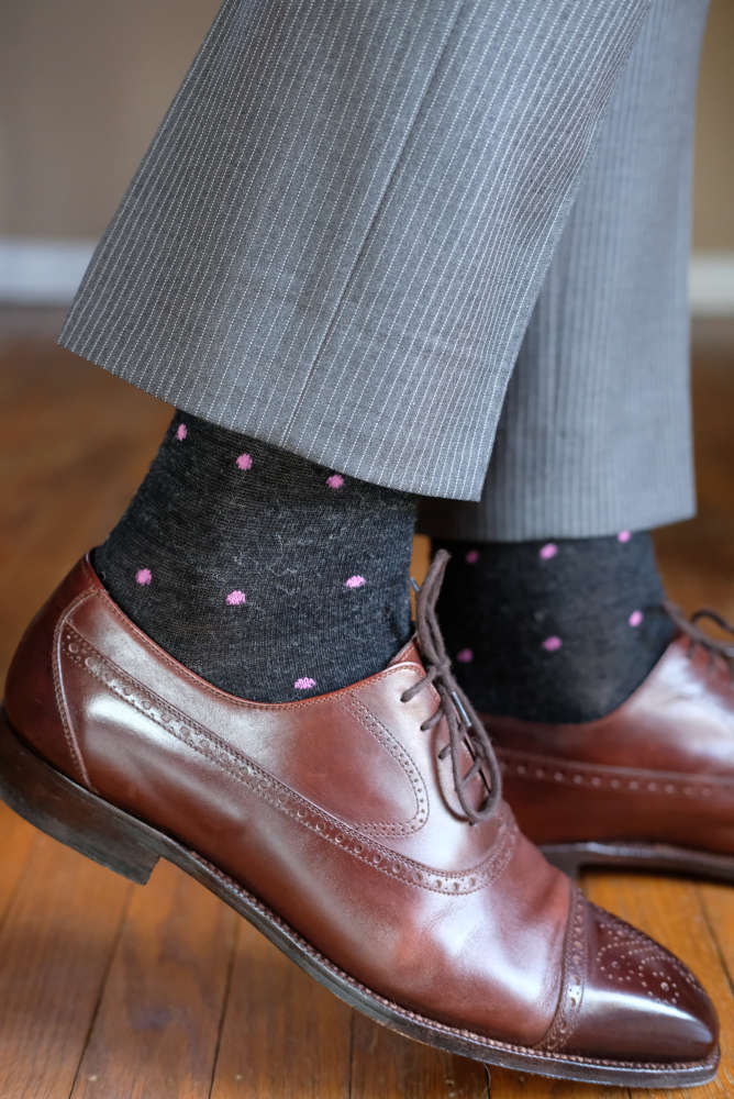 charcoal grey merino wool dress socks accented with bright pink polka dots