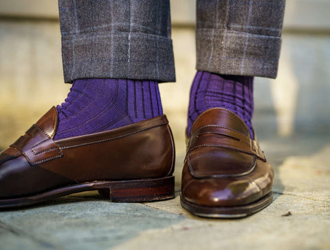 purple dress socks with loafers and windowpane trousers