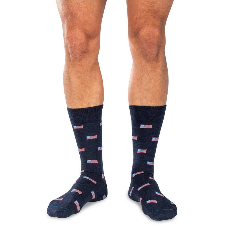 Man Wearing Mid-Calf Length Navy Blue Wool Dress Socks with Small American Flags