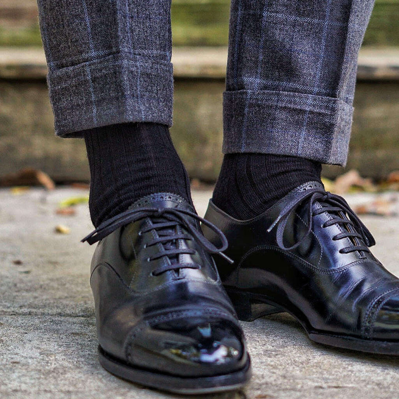 Man Wearing Black Merino Wool Dress Socks with Windowpane Trousers