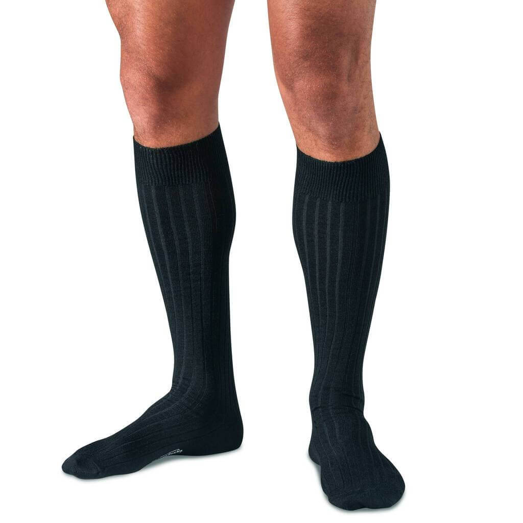 Man Wearing Black Merino Wool Over the Calf Dress Socks